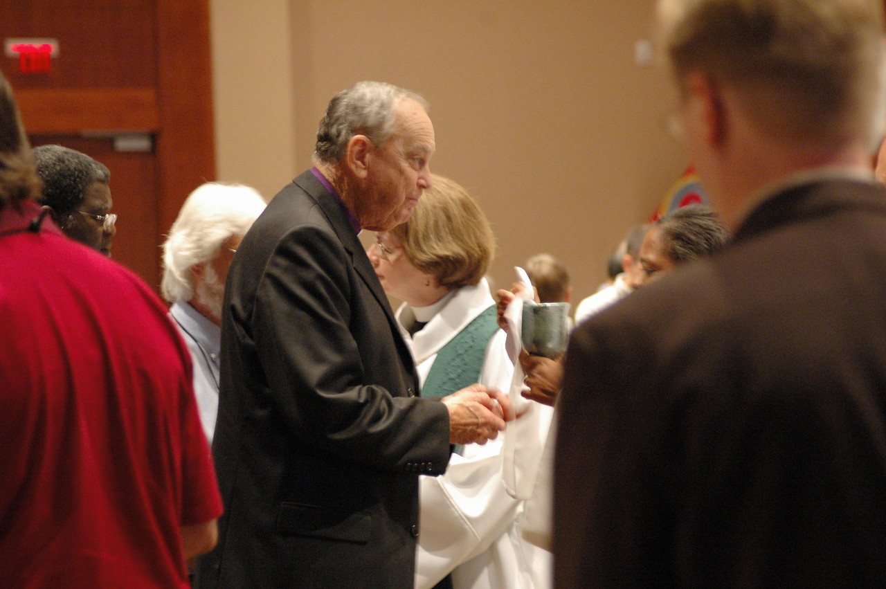The Rev. William Oden, United Methodist Church, takes communion during Thursday's worship service. Earlier on Thursday, the assembly enthusiastically passed Interim Eucharistic Sharing with the United Methodist church, often preliminary step to a Full Communion Relationship.