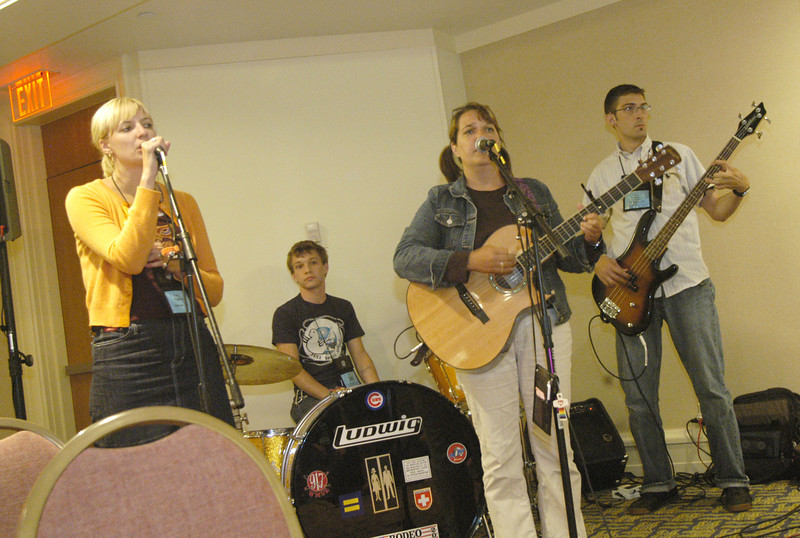 Pastor Gretchen Weller's band plays to the youth at the Youth Convo baptism renewal reception.