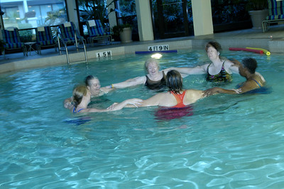 Tiffany Greenis (far left), who normally teaches for L.A. Fitness, takes charge of Swm Aerobics - part of the Run, Walk, Roll (and Swim) early-morning activity sponsored by the Board of Pensions at the ELCA Churchwide Assembly. Go to http://www.elca.org/assembly/05/happenings/index.html
