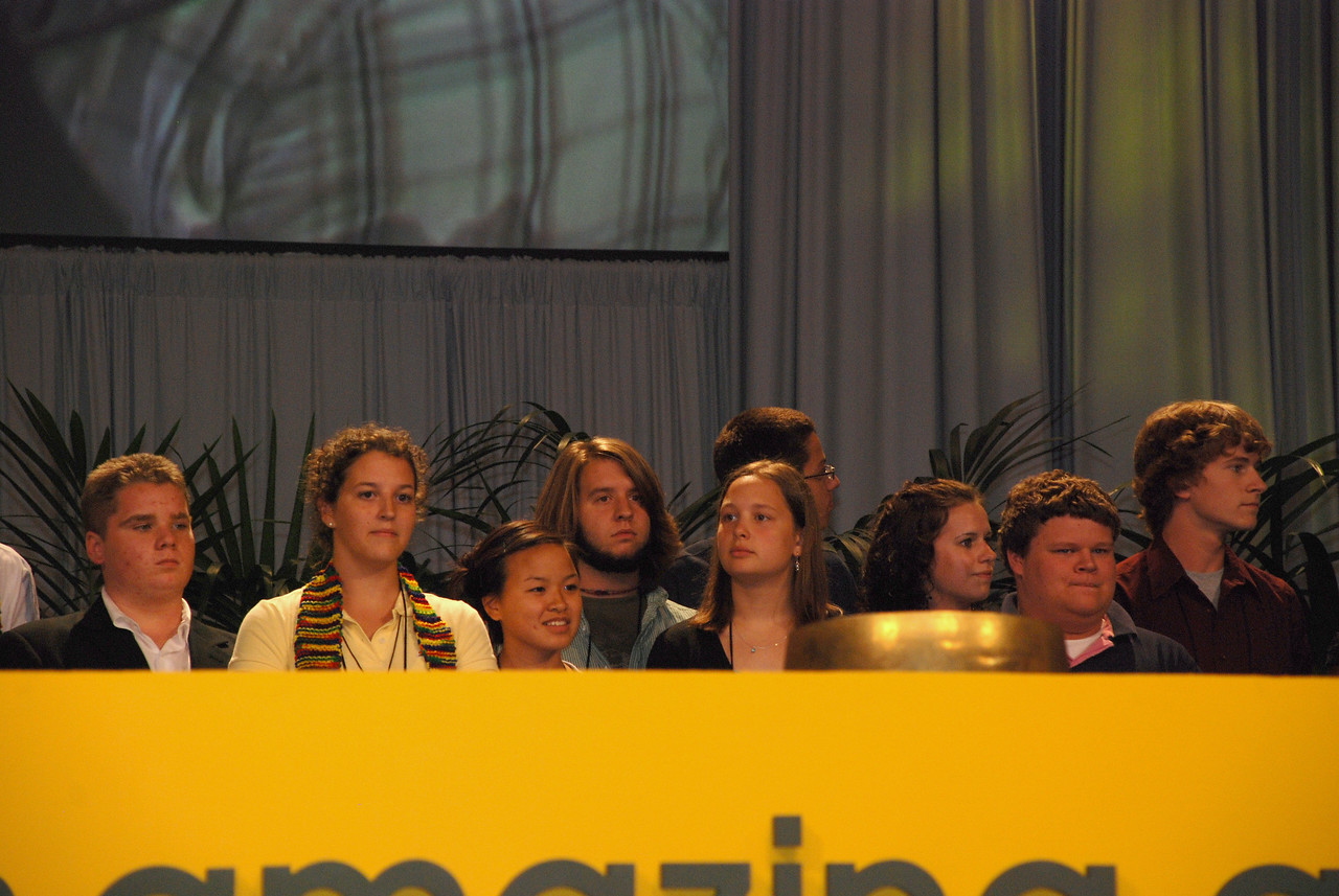 Youth Convocation during Plenary session 9 on stage having fun.