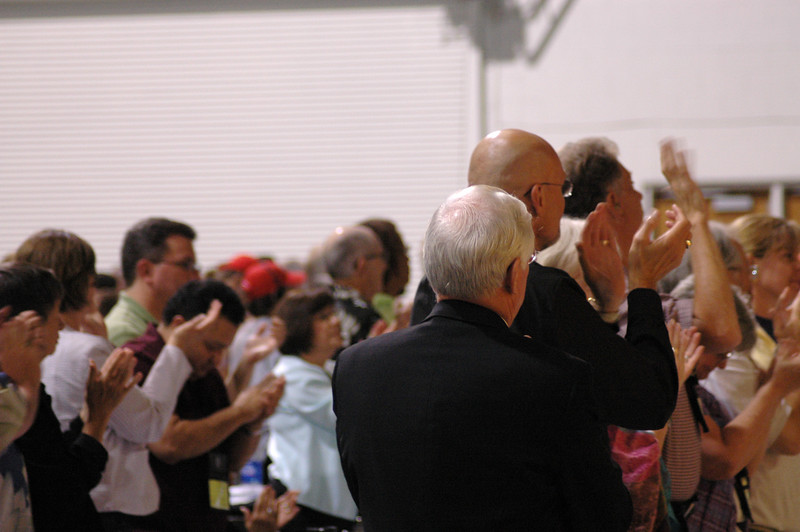 The assembly applauds the Rev. Michael Cooper-White after the report of the fourth ballet for Secretary.