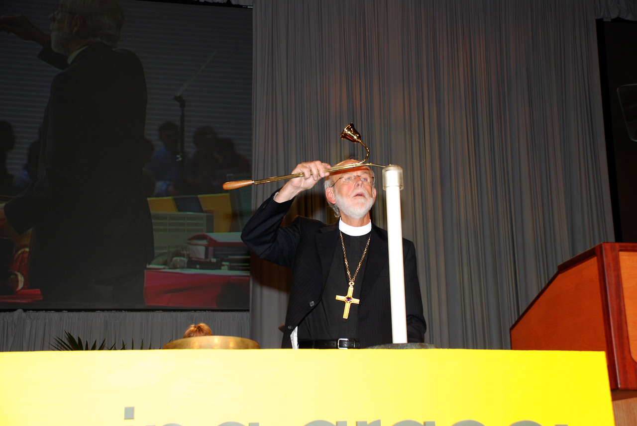 Bishop Hanson lighting the candle for during opening prayer at the Plenary 8 session.