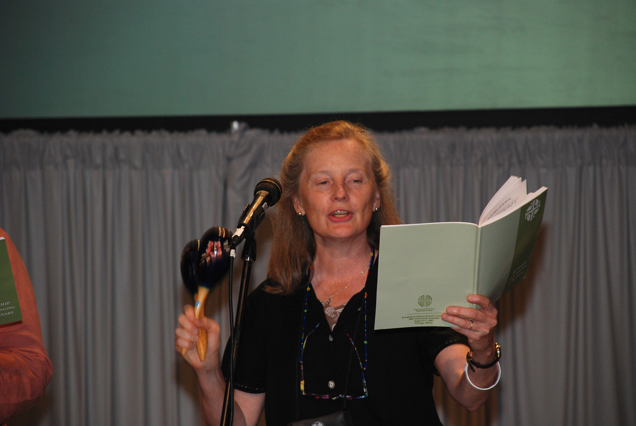 Pr. Elaine Hewes, Blue Hill, Maine sings with The Assembly Musicians at Plenary 8 session.