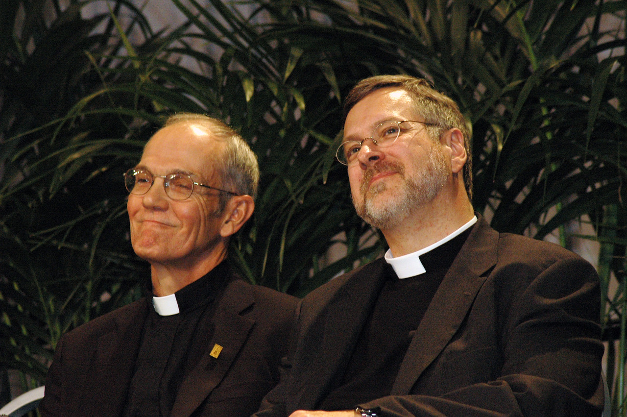 The Rev. Michael Cooper-White and the Rev. Paul Schreck wait to speak to the assembly.