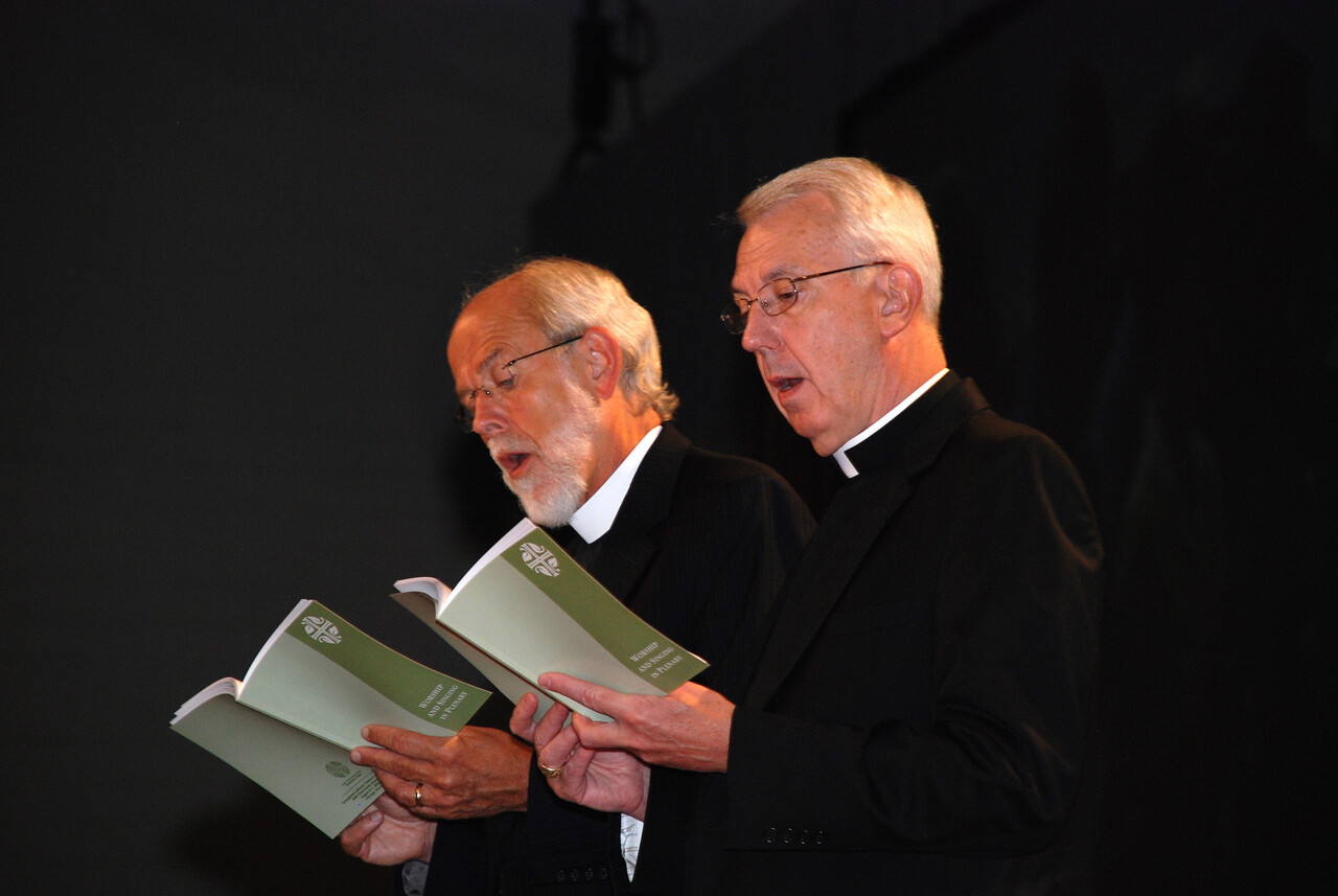 Bishop Hanson, and The Rev. Lowell G. Almen, Secretary of the Evangelical Lutheran Church in America during opening prayer at the Plenary 8 session.