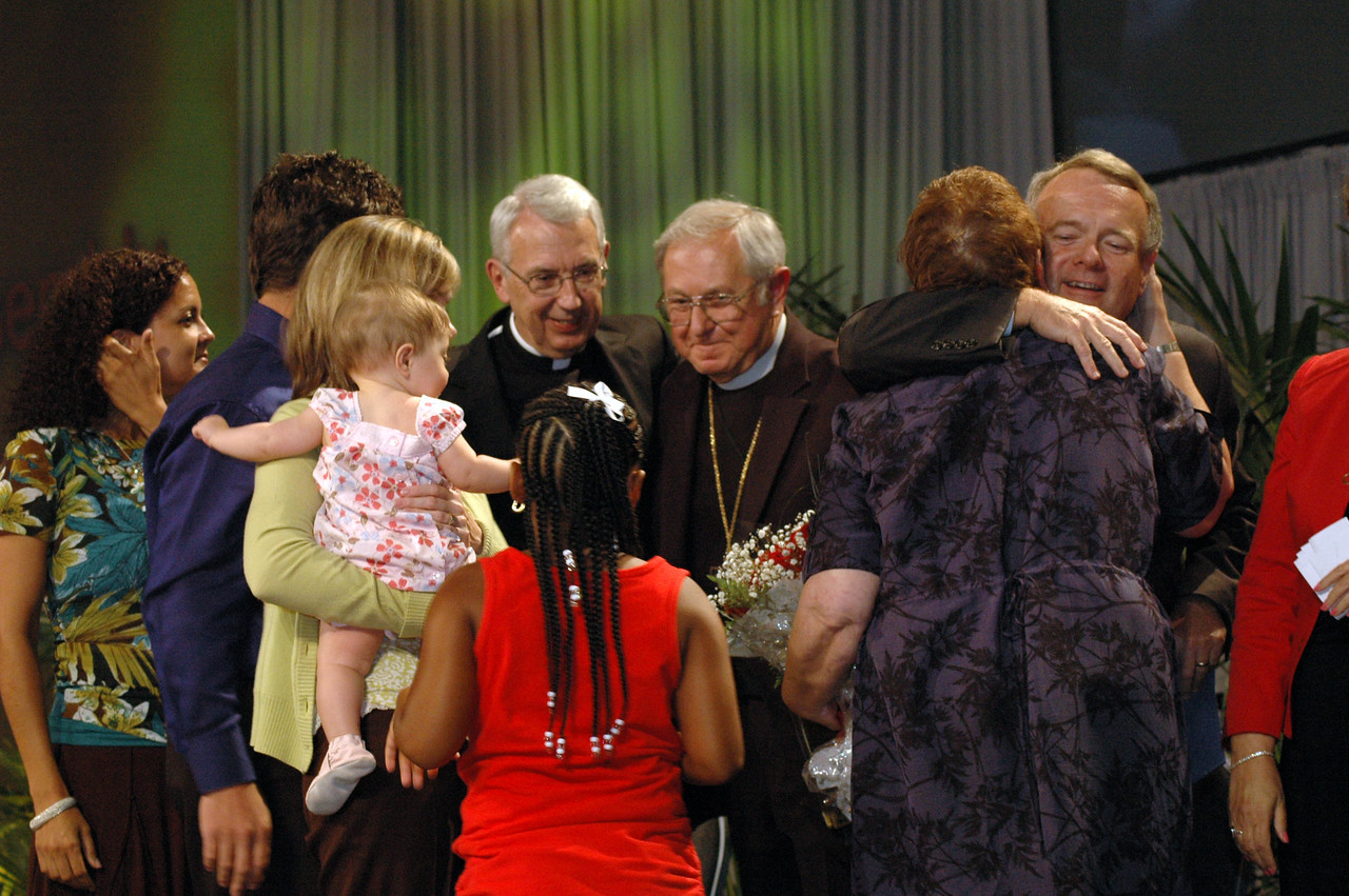 Lowell Almen and his family are congratulated on receiving the Servus Dei medal.
