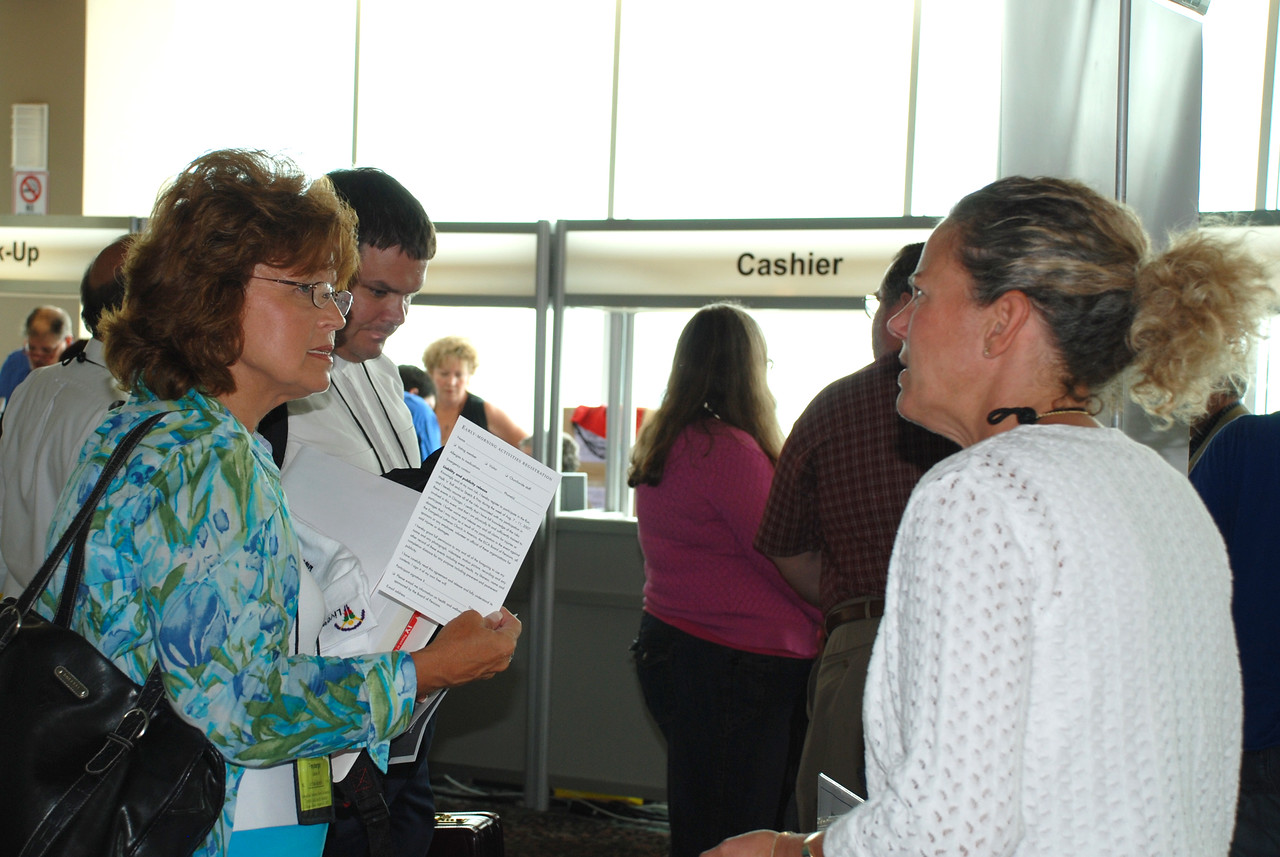 Melanie Freyberger inquiring about information at the Board of Pensions booth.