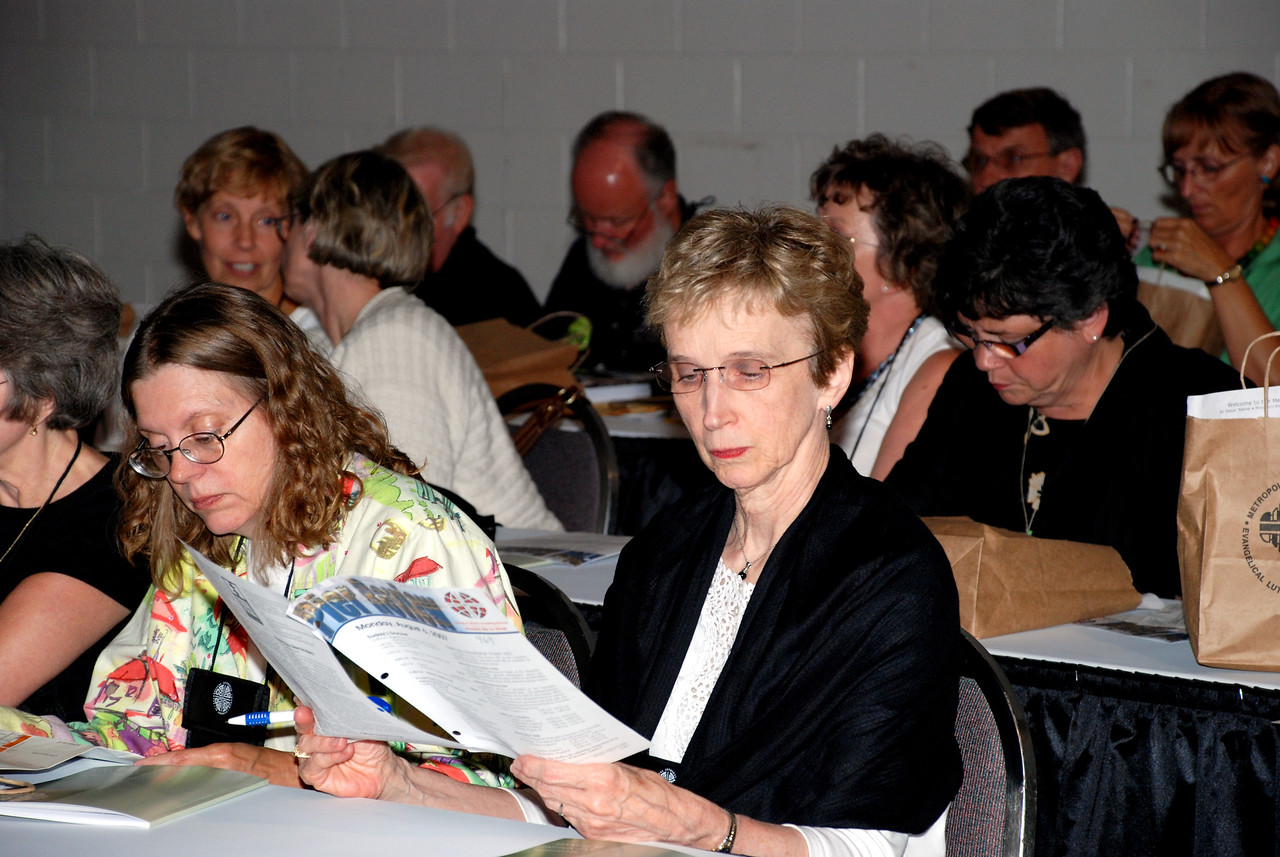 Voting Member reviewing CWA materials.