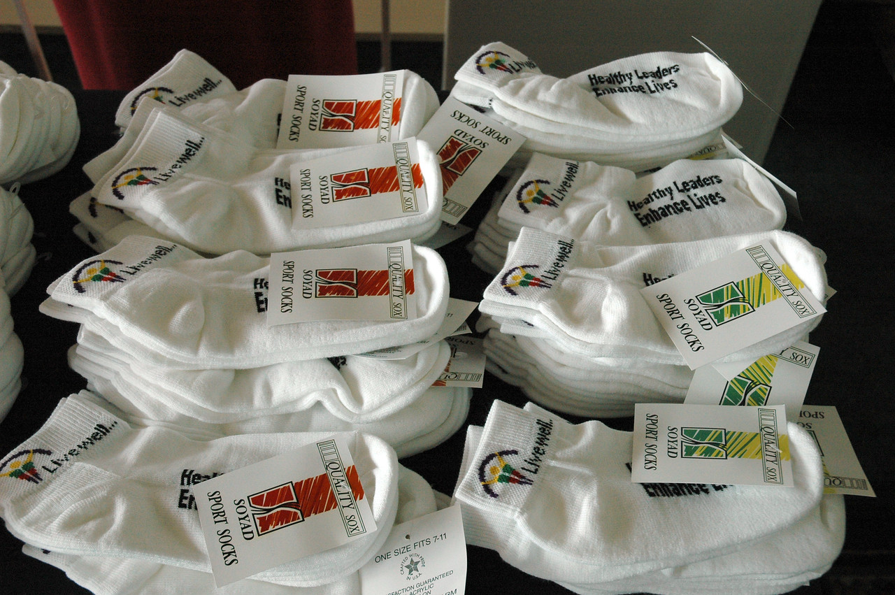 """""""Livewell... Healthy Leaders Enhance Lives"""" socks are given out by the Board of Pensions during registration."""