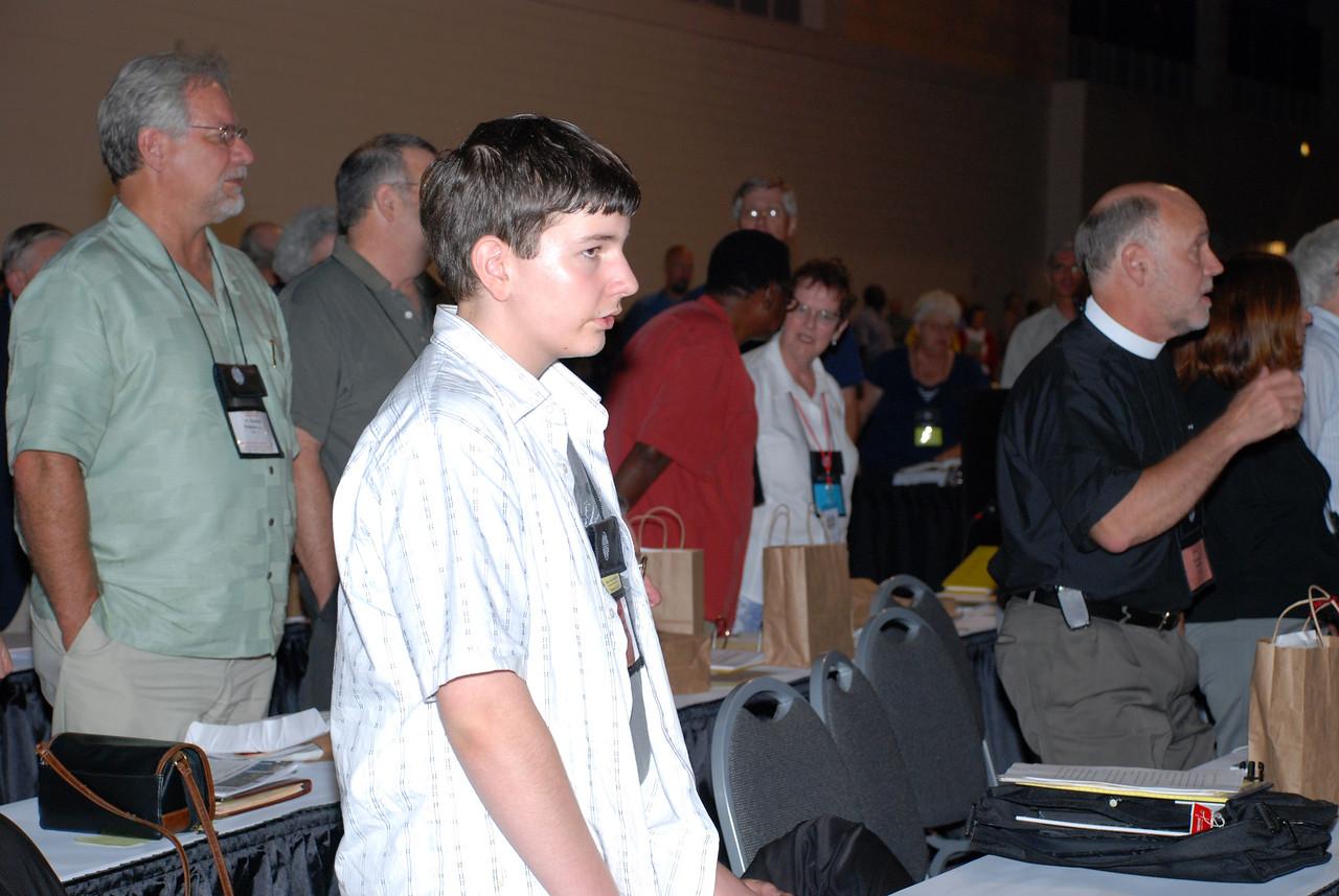 Voting Members listening to Bishop Hanson.