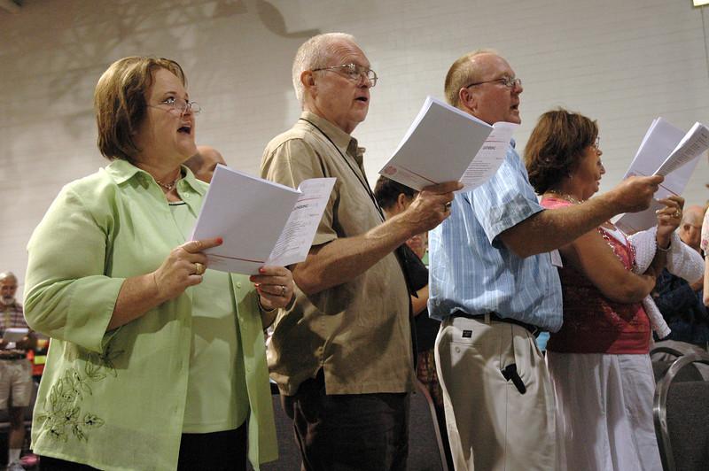 Voting members singing during opening worship