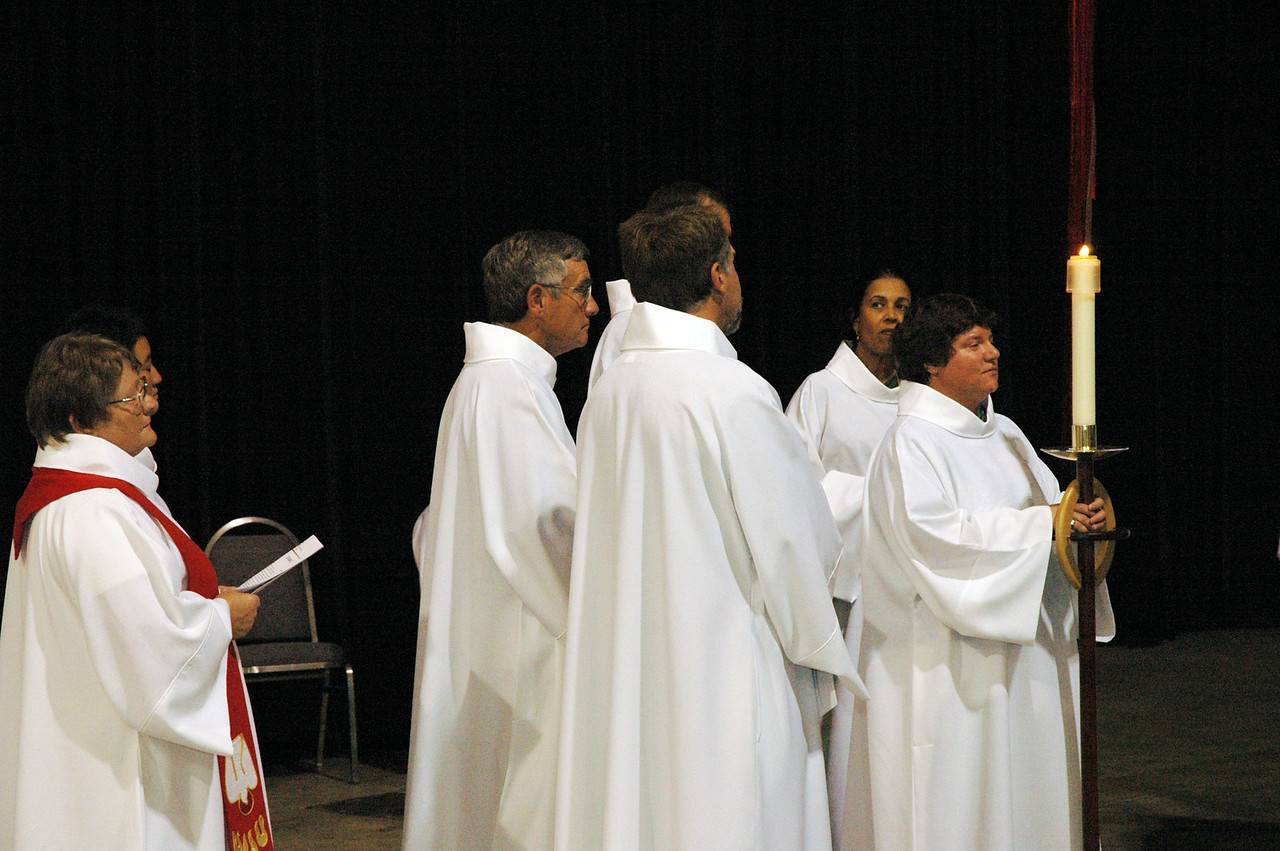 Candlebearer and other worship assistants wait for opening worship to begin