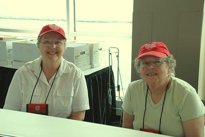 Carol Kaspar and Pr. Vivian Becker helping out at the registration booth.