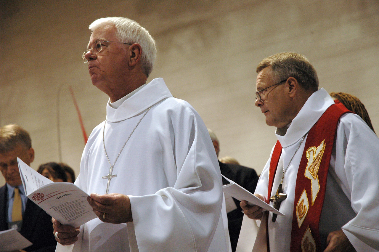 Rev. Allan Bjornberg, bishop of the Rocky Mountain Synod and Roy Riley, bishop of the New Jersey Synod, participate in opening worship at the 2007 ELCA Churchwide Assembly.