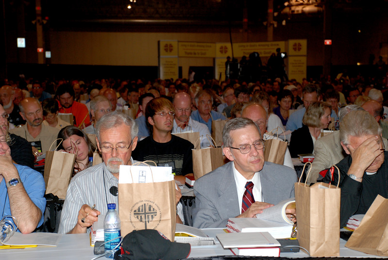 Voting Members looking up information.