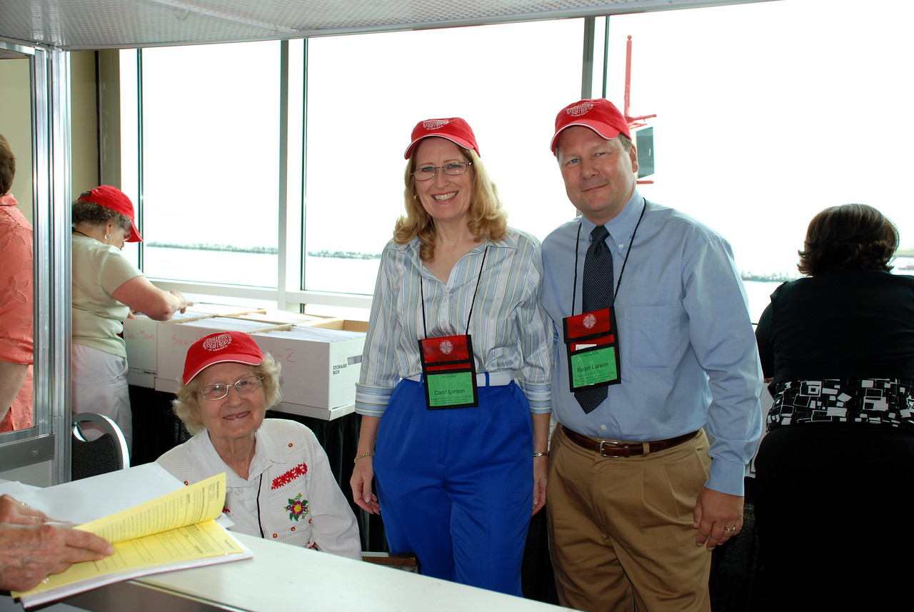 Iola Larson with Carol and Ralph Larson helping out at the volunteer booth.