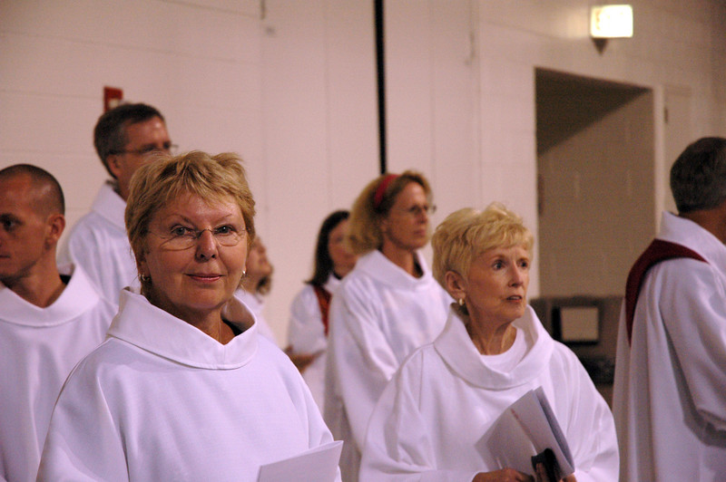 Worship assistants wait for opening worship to begin