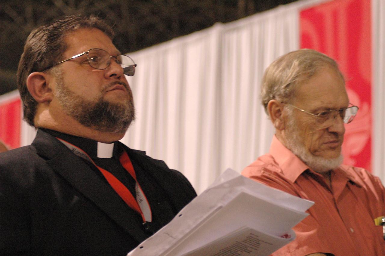 Voting members follow along in worship