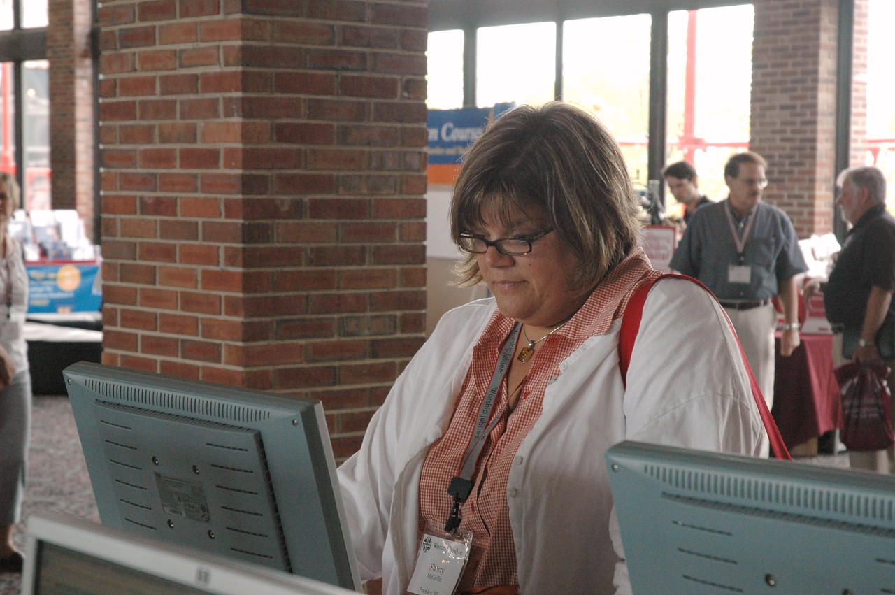 Sherry McGuffin takes advantage of the Email center at Navy Pier before heading home to Petoskey, MI. Sherry was present at the Worship Jubilee this past weekend.