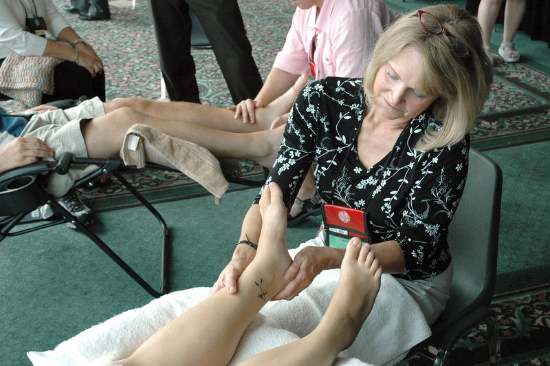 Lesley Connors offers a foot massage to a voting member Monday. The reflexology sessions are offered free on Monday, Tuesday and Friday of the assembly by CNS Home Health & Hospice.