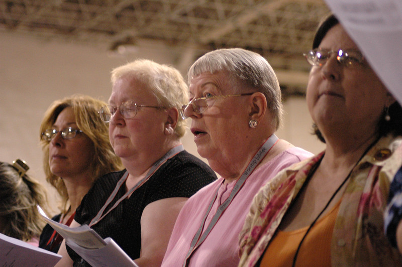 Voting members singing during opening worship