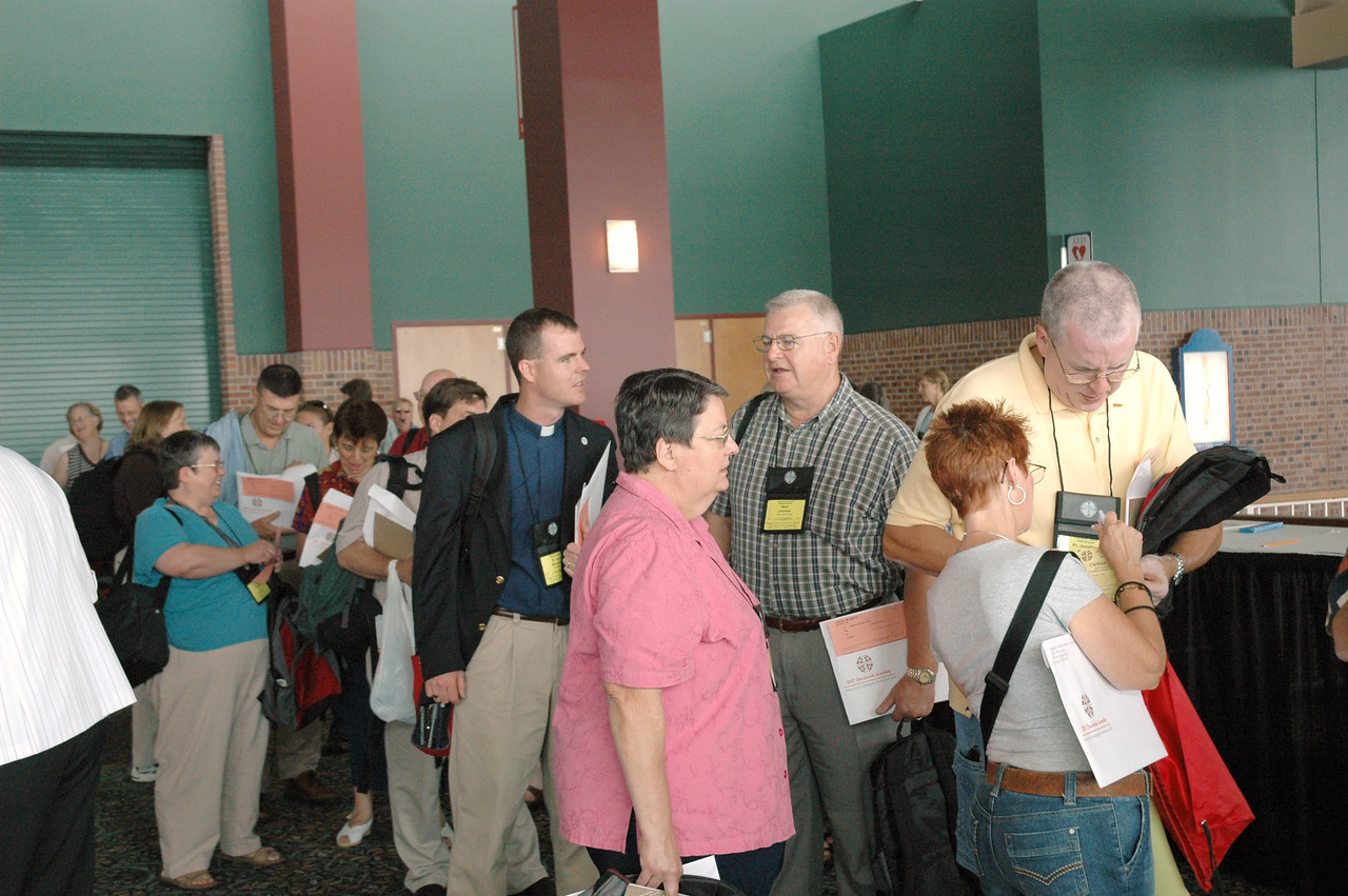 Voting members stand in line for registration.