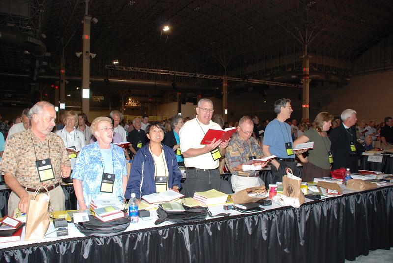 Voting Members singing at Plenary meeting.