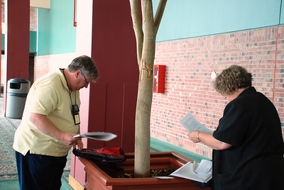 Pr. Allen Campbell and Pr. Beth Schlegel are reviewing todays agenda.