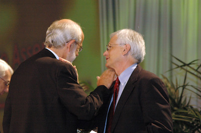 Presiding Bishop Mark Hanson congratulates David Swartling after he was elected as the new secretary of the ELCA.