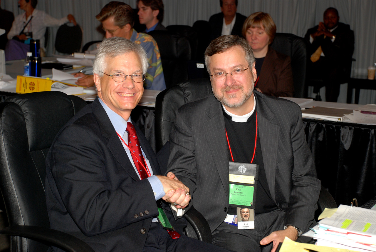 David Swartling and The Rev. Paul Schreck wishing each other luck seconds before the winner was announced.