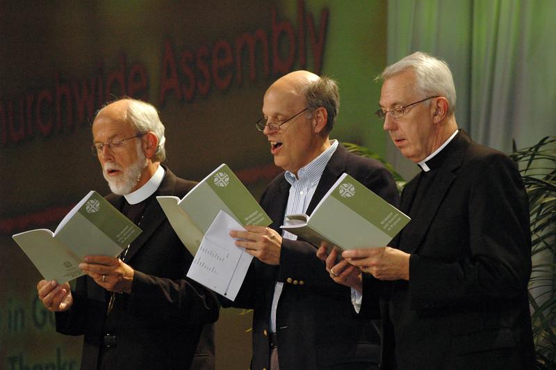 Mark Hanson, presiding bishop, Phil Harris, General Counsel and Lowell Almen, ELCA Secretary sing after the Ecumenical greetings.