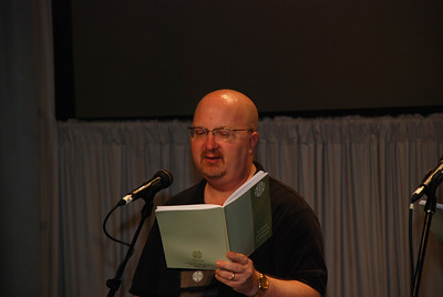 Assembly musician, Doug Albert from Gap, Pa. sings at Plenary 6 at Churchwide Assembly.
