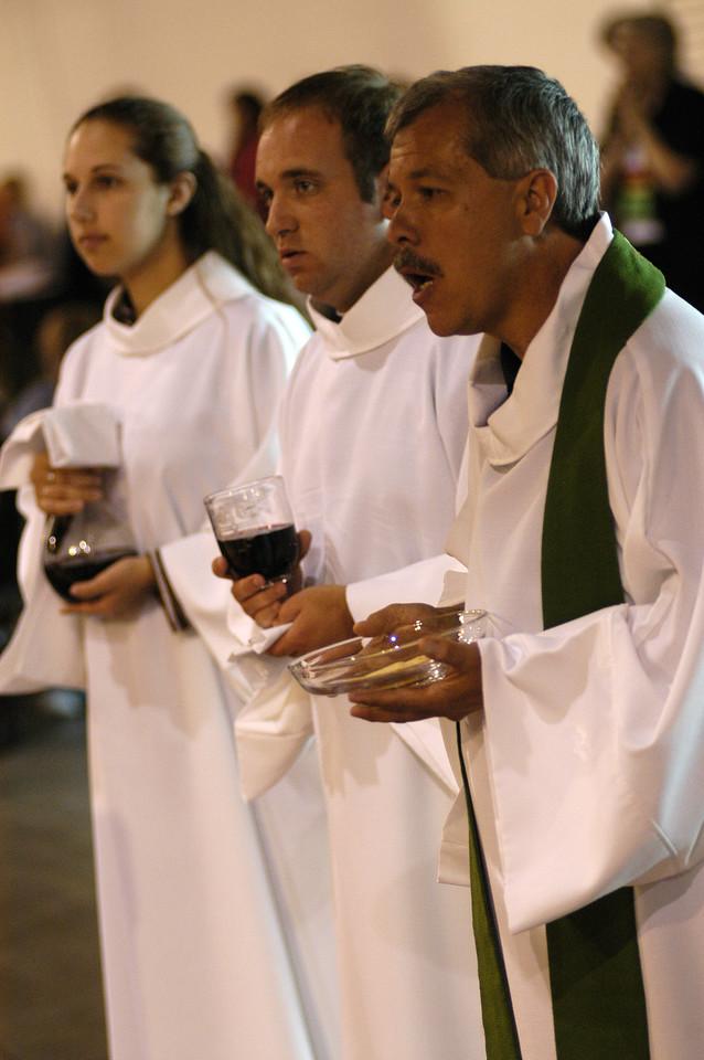 Communion assistants during Thursday'a worship service.