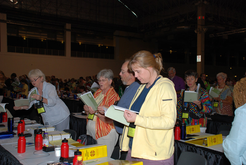 Voting Members being led into prayer by Bishop Leonard Bolick at Tuesday's Plenary session.