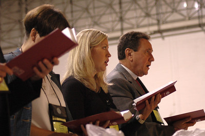 Voting members sing during Plenary session 2.