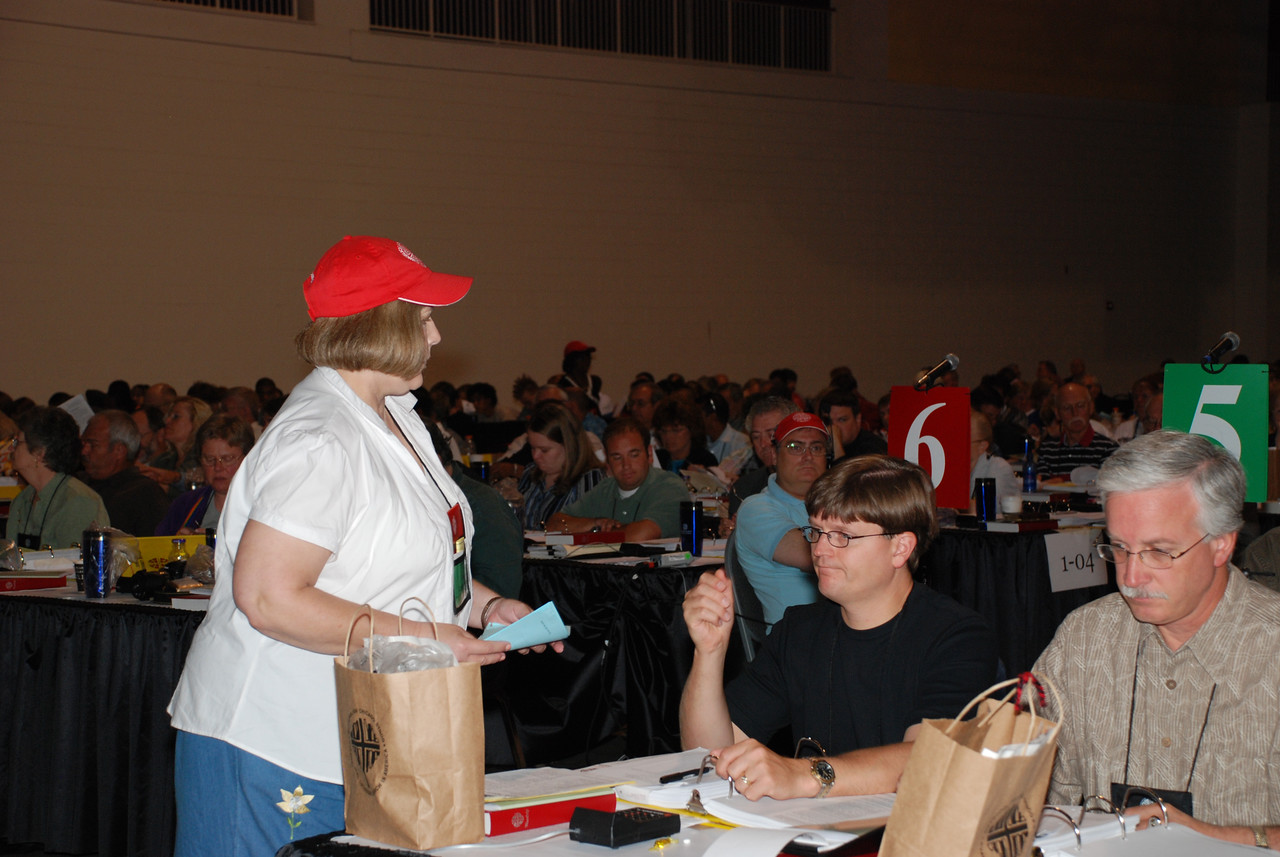 Volunteer Member collecting ballots for the nomination of the New Presiding Bishop.