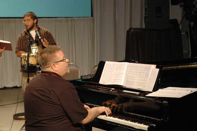 Scott Weidler, Associate Director for Worship and Music plays the piano during plenary