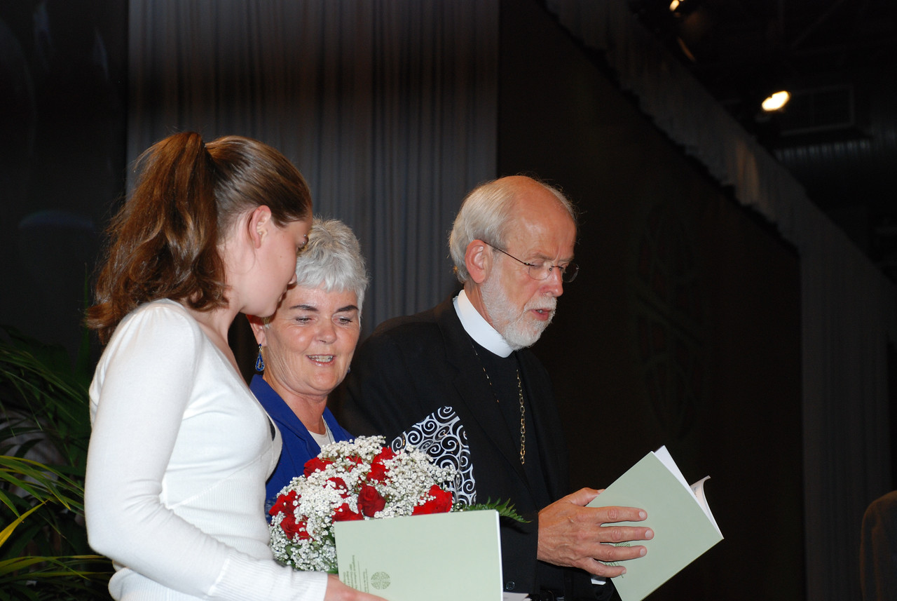 Ione and Elizabeth Hanson on stage during prayer with newly elected Bishop Hanson.