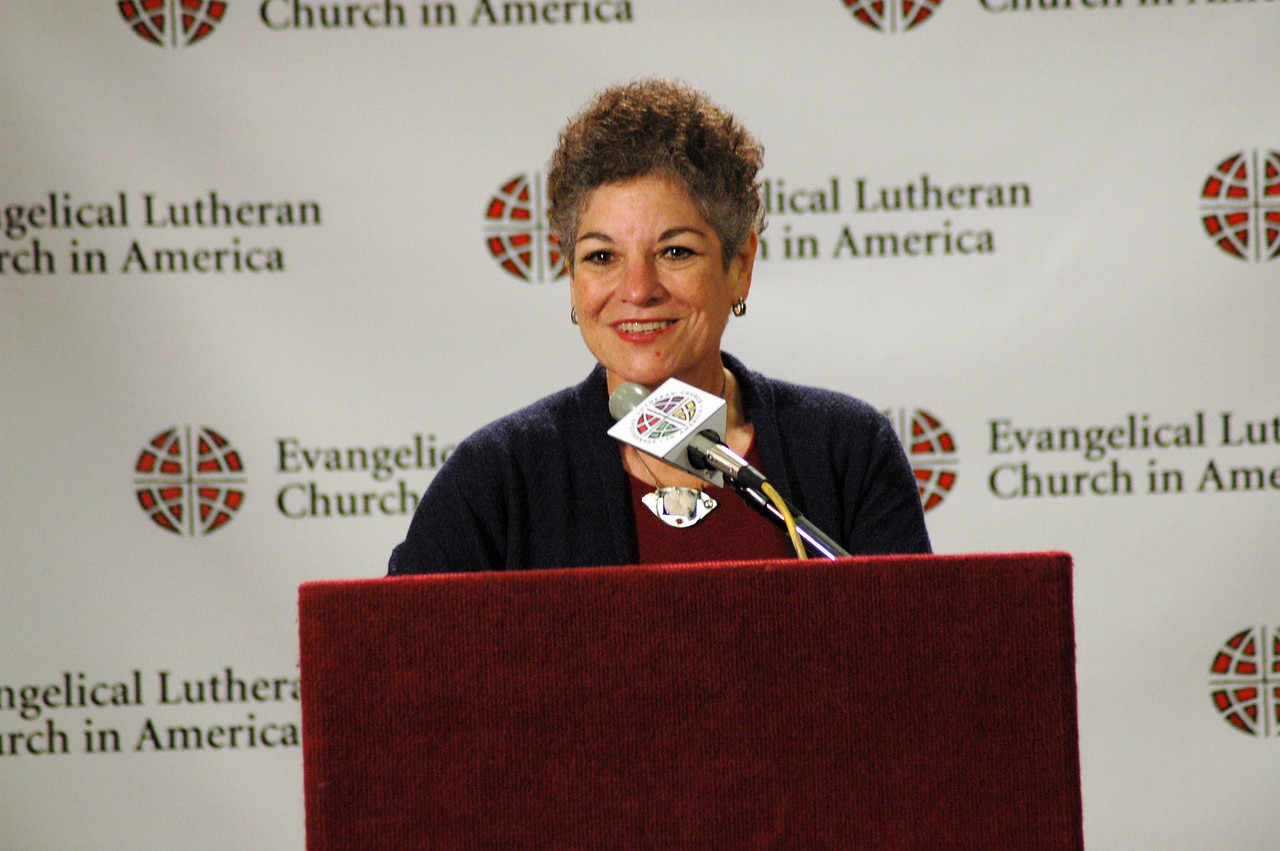"Dr. Diane Jacobson, associate in ministry, Luther Seminary, St. Paul, Minn. answers questions at the press conference for ""Book of Faith."""