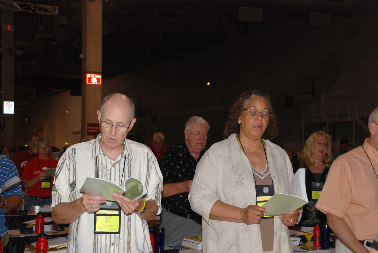 Voting Members being led into prayer at Tuesday's Plenary session.