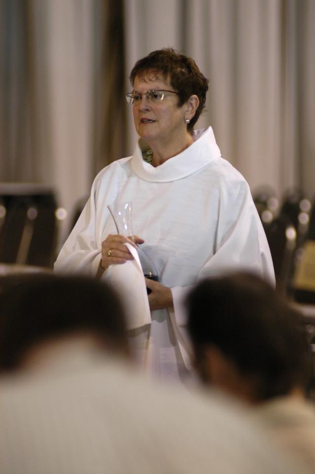 Communion assistant Sally Almen.