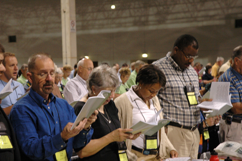 Plenary session four opens with morning prayer and hymns.