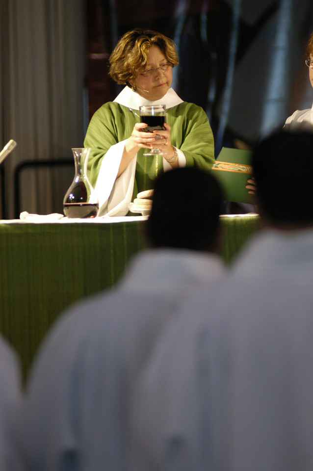 Blessing of the wine during Holy Communion at worship service.