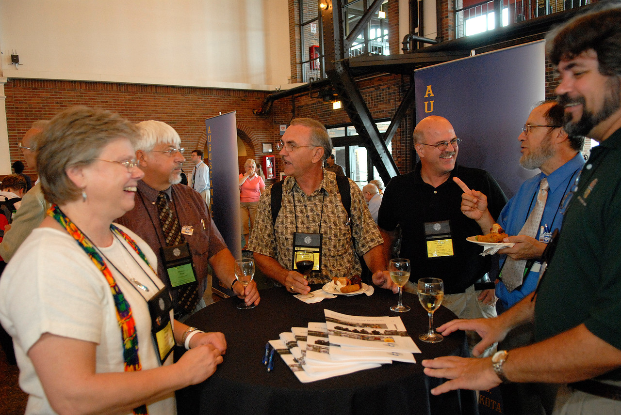 Various campus ministry professionals help celebrate the 100th Anniversary of Campus Ministry.