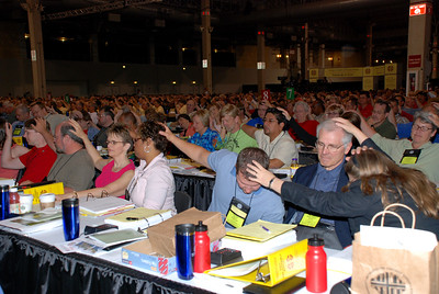 In prayer at Plenary session on Wednesday.