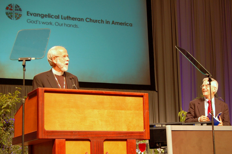 Presiding Bishop Mark S. Hanson officially opens the 2009 ELCA Churchwide Assembly as Secretary David Swartling looks on. The churchwide assembly, the chief legislative authority of the ELCA, is meeting August 17-23 at the Minneapolis Convention Center.