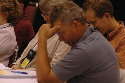 Voting members take a moment to pray before voting.