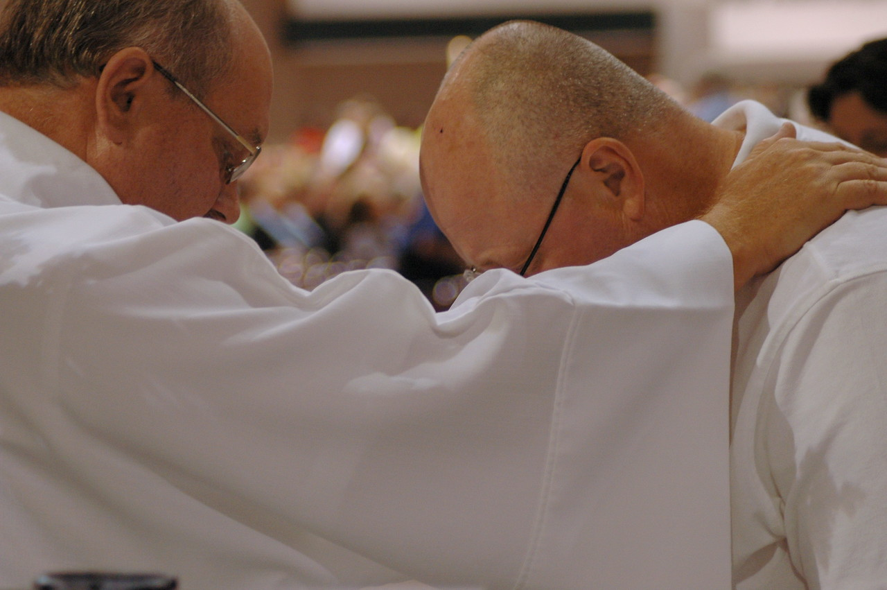 Prayer during Friday's service of Word and Sacrament.