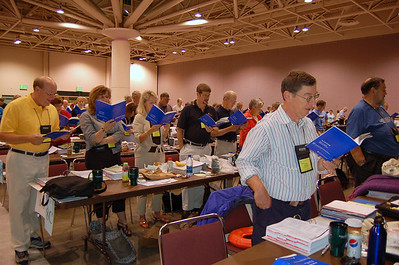 Voting members sing during a plenary session of the 2009 Churchwide Assembly of the Evangelical Lutheran Chuch in America.
