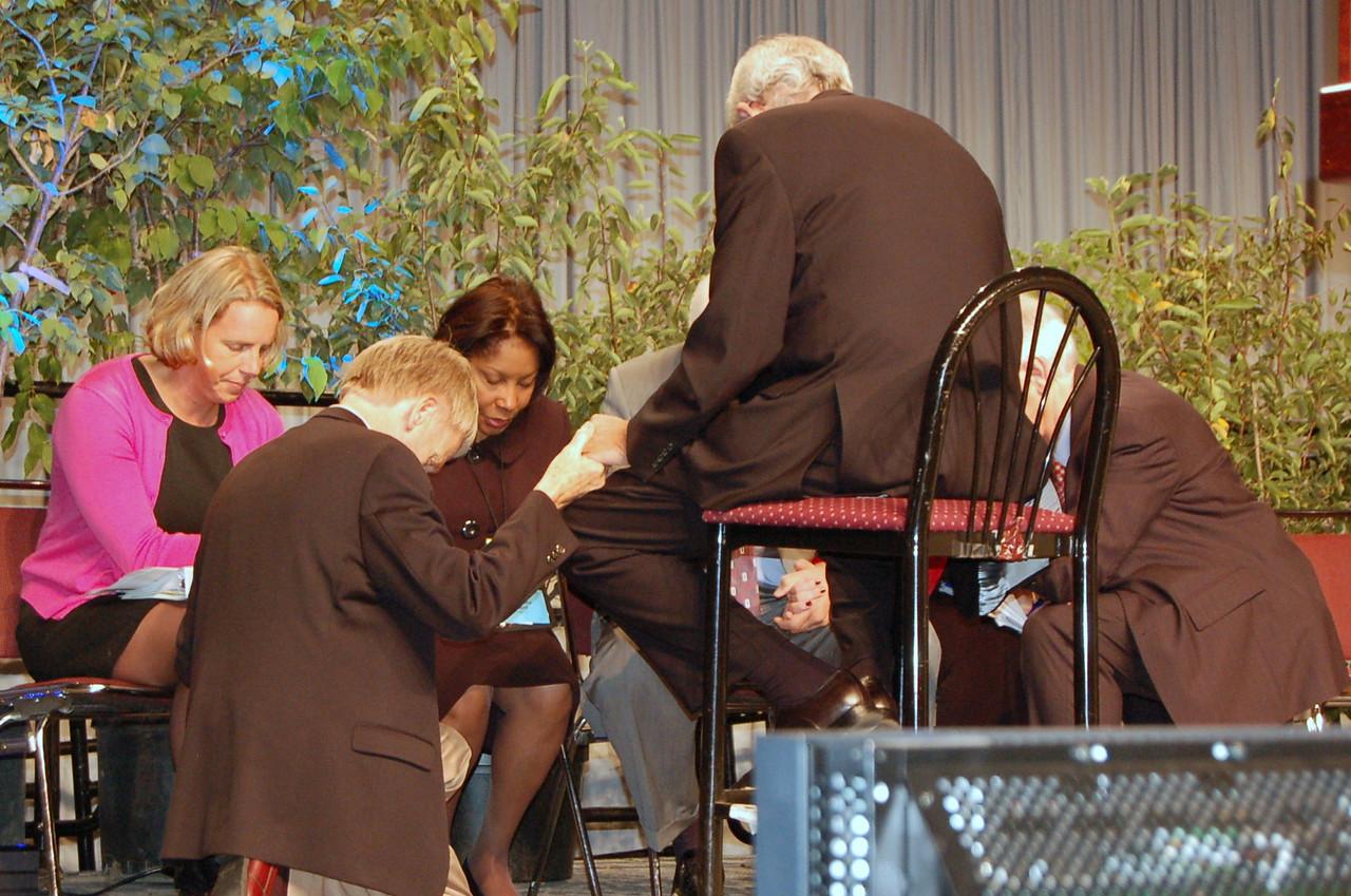 Praying on stage.